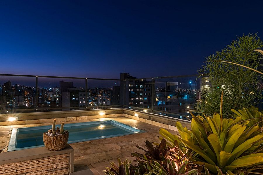 Pool with city views and a relaxing hangout