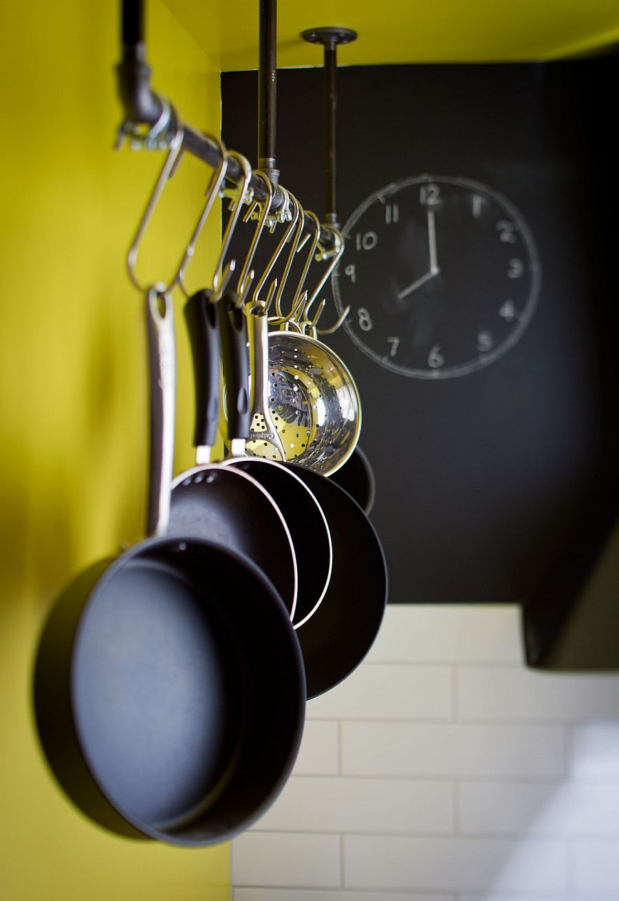 Pot rack in the kitchen fits in perfectly with the home's industrial flair