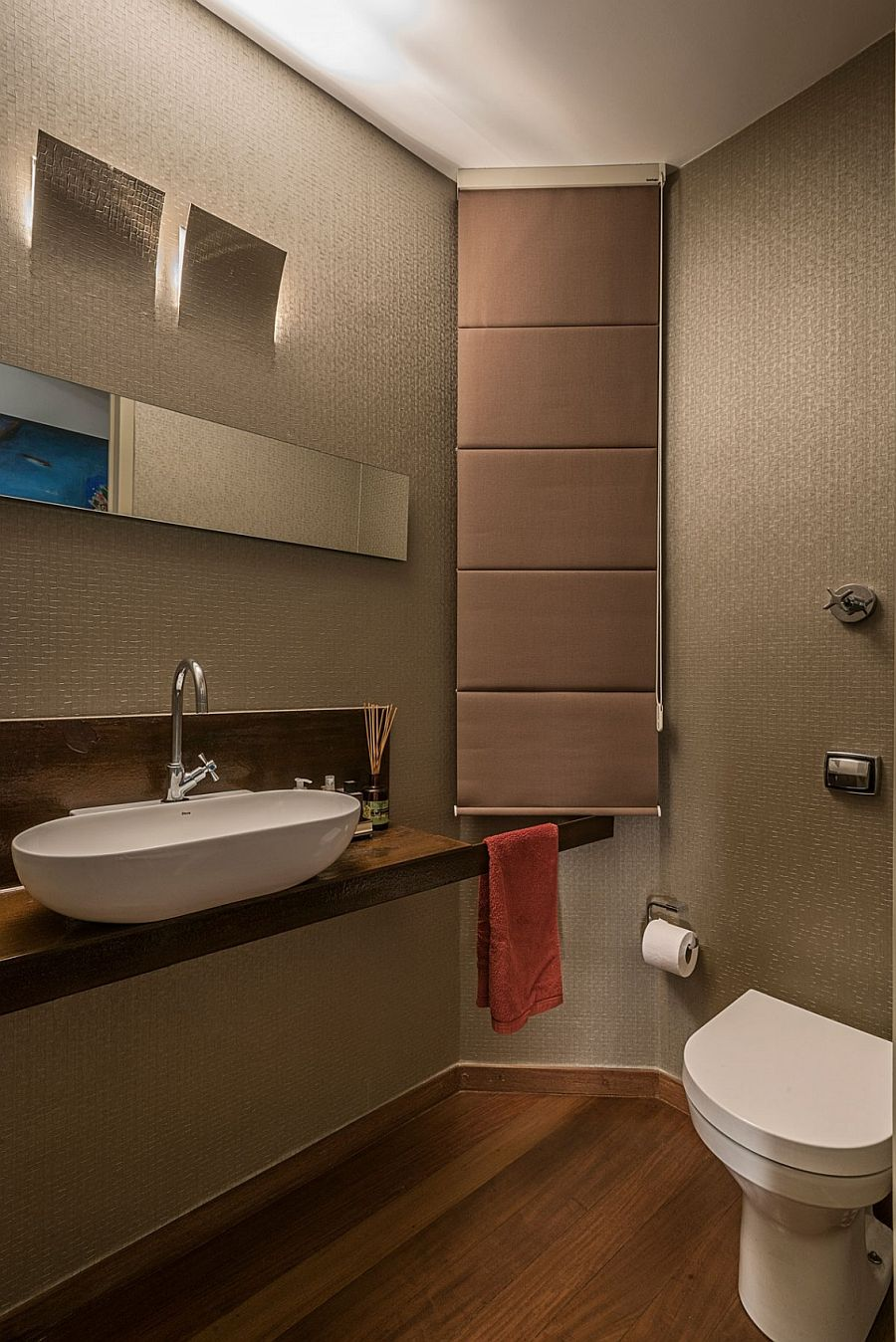 Powder room on the first level is kept simple and modern with minimal color