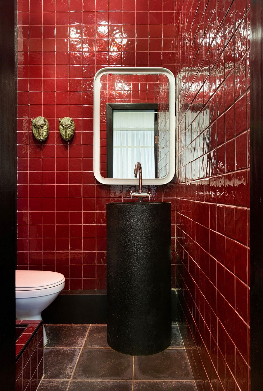 Red tile create a unique and stylish bathroom with touches of black