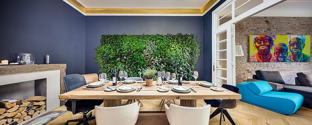 Refreshing green wall adds much more than just color to the unique dining room [Design: Lindberg Design]