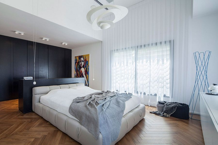 Relaxing master bedroom with custom cabinets and headboard design