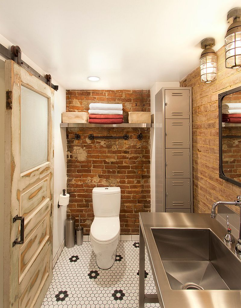 Salvaged decor shapes small industrial bathroom with exposed brick walls [Design: Bennett Frank McCarthy Architects]