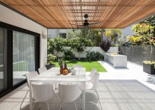 Shaded outdoor dining space at the contemporary home in Ramat HaSharon