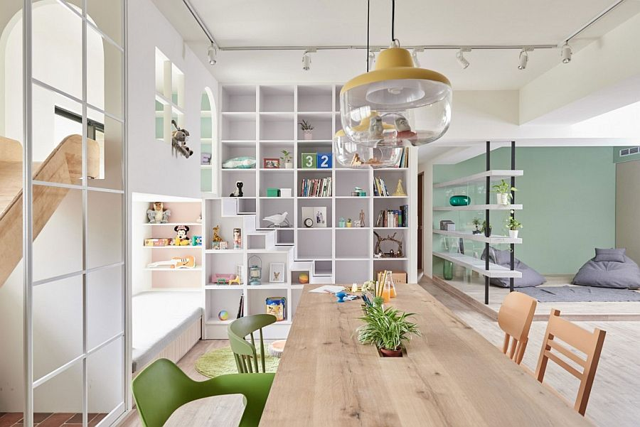 Shelves and architectural features demarcate spaces in the open plan living area