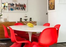 Sizzling Panton S chairs in red steal the show in this dining room