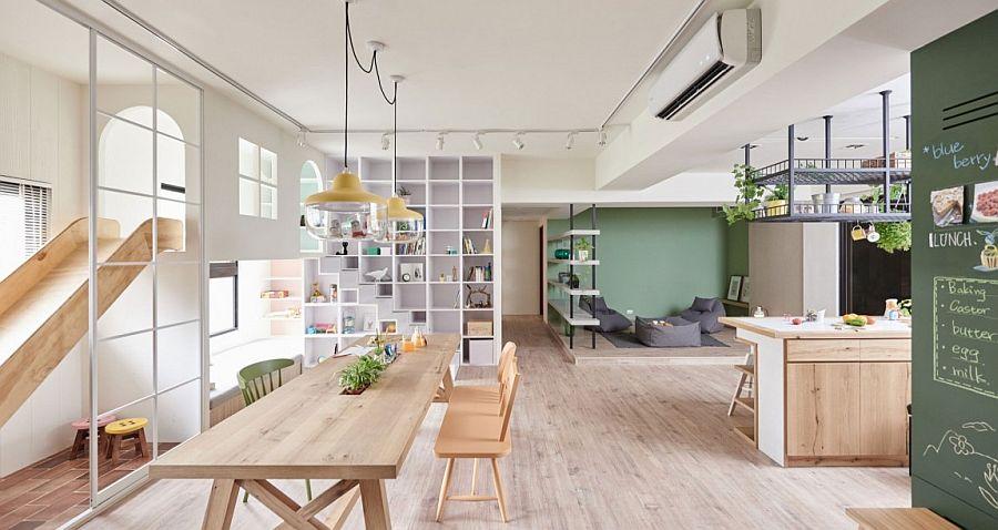 Slide, playroom, swing and ample storage space shape a versatile playroom