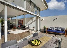 Sliding glass doors connect the living room with the outdoors