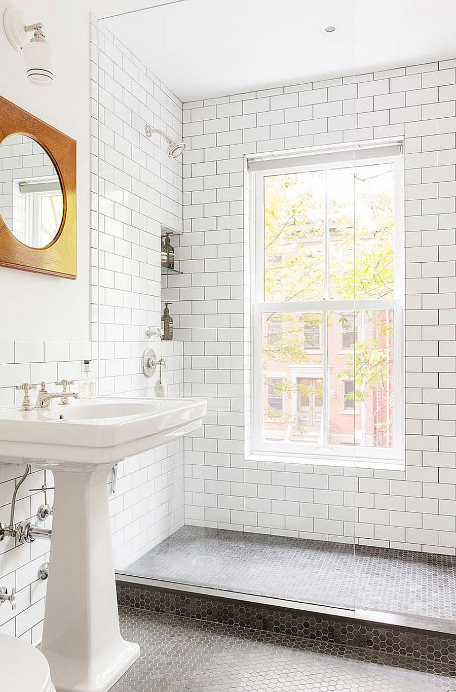 Small modern bathroom with glass shower area and penny tile flooring