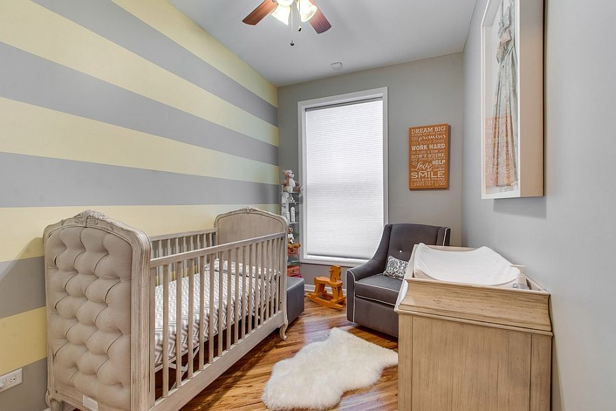 Small nursery design with striped accent wall [Design: Steele Consulting Group]