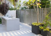 Small private courtyard with outdoor sitting, dining and kitchen