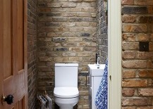 Small-rustic-bathroom-with-brick-walls-and-skylight-217x155