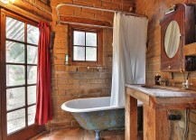 Small-rustic-bathroom-with-weathered-bathtub-and-brick-backdrop-217x155