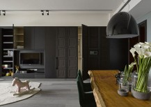 Smart-cabinets-in-the-living-area-blend-into-the-dark-backdrop-seamlessly-217x155