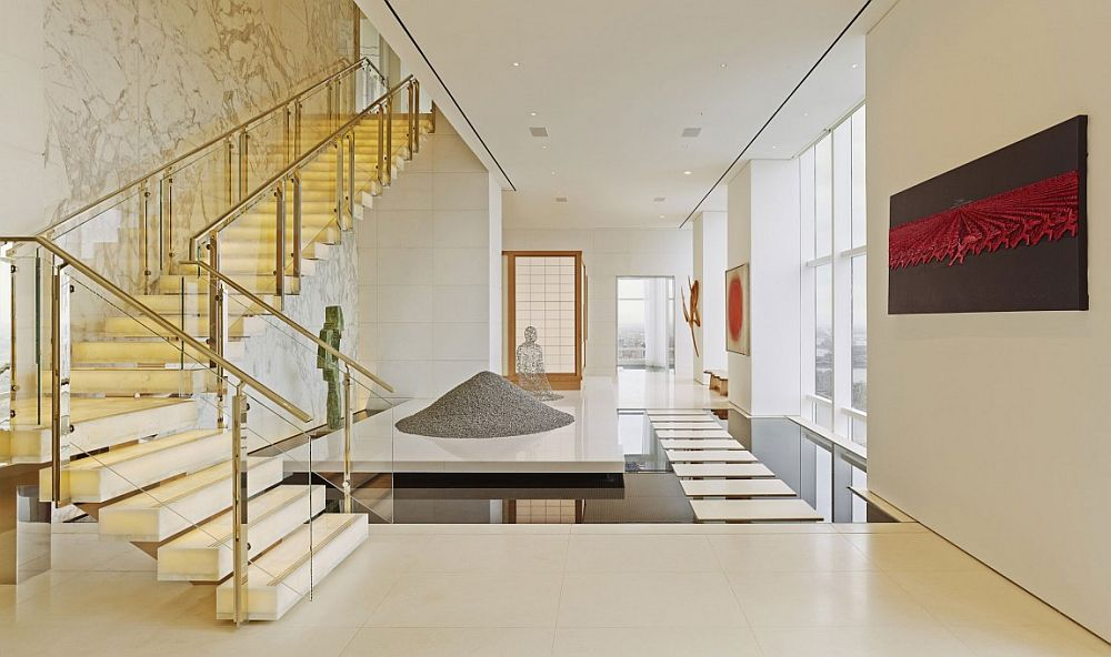 Spectacular entrance of NYC apartment with reflecting pond stepping stones and waterfall Breathtaking Opulence: Posh New York City Penthouse Leaves You Awestruck