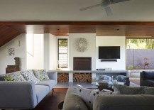 Stacked-wood-creates-textural-contrast-in-the-living-room-217x155