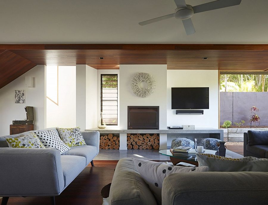 Stacked wood creates textural contrast in the living room