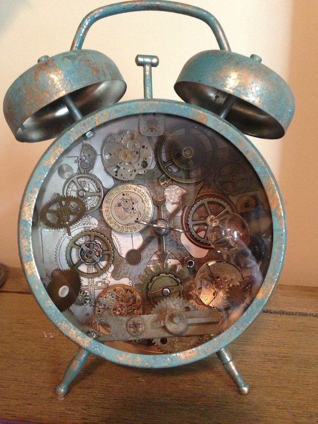 Steampunk altered alarm clock with lots of gears
