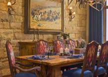 Stone wall and antler lighting for the rustic dining room