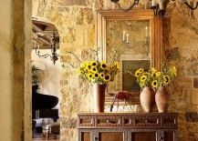 Stone walls and custom decor give the entry a Tuscan flavor