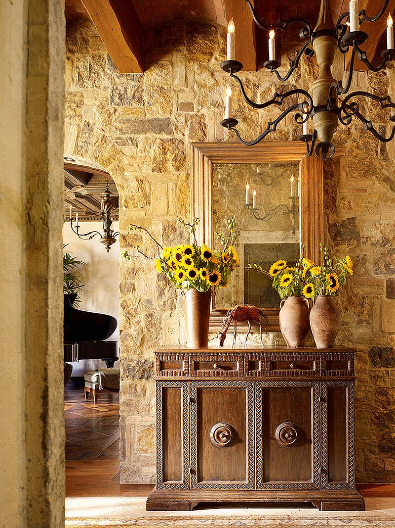 stone walls and custom decor give the entry a tuscan flavor design