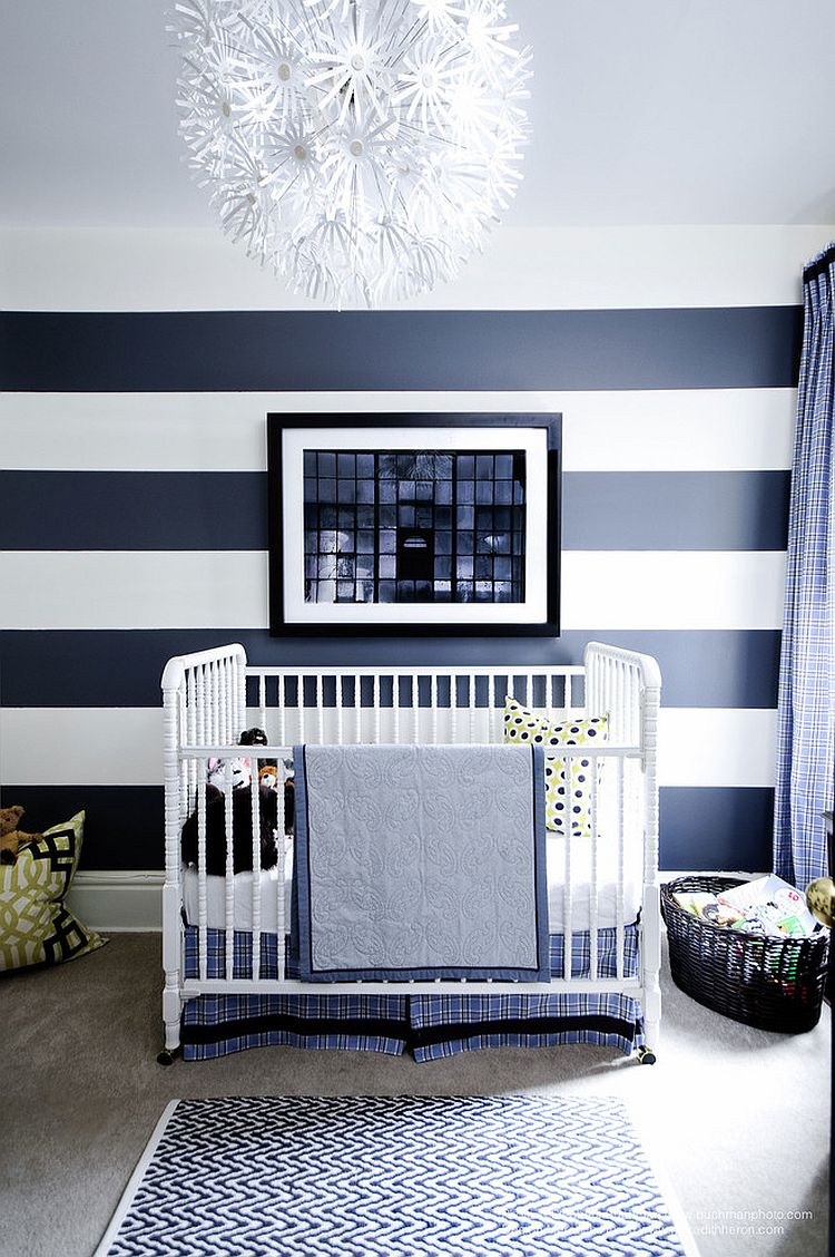 Striped accent wall brings refinement to the contemporary nursery [Design: Meredith Heron Design]