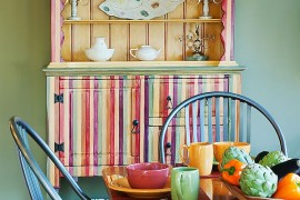 Striped and multi-colored hutch makes for a flamboyant dining room addition