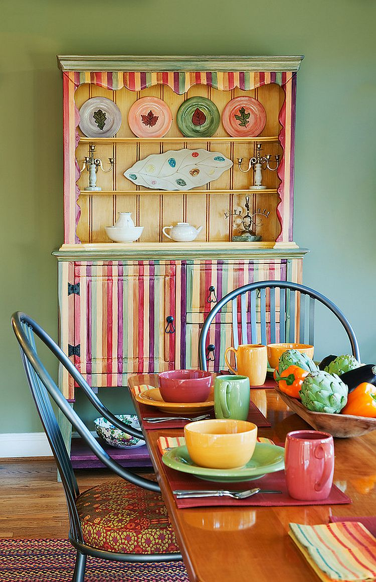 Striped and multi-colored hutch makes for a flamboyant dining room addition [Design: Carol Freedman Design]