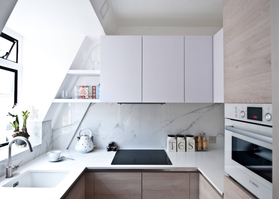 Studio apartment kitchen with marble and wood