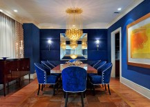Stunning dining room in royal blue with glittering gold lighting