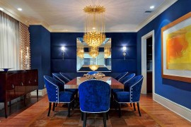 Stunning dining room in royal blue with glittering gold lighting 270x180 Visual Feast: 25 Eclectic Dining Rooms Drenched in Colorful Brilliance!