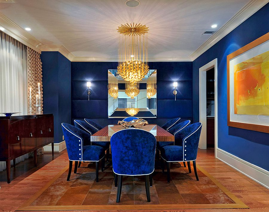 Stunning dining room in royal blue with glittering gold lighting [Design: Carolyn Miller Interiors]