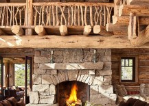 Stunning stone fireplace becomes the focal point of the cozy, rustic living room
