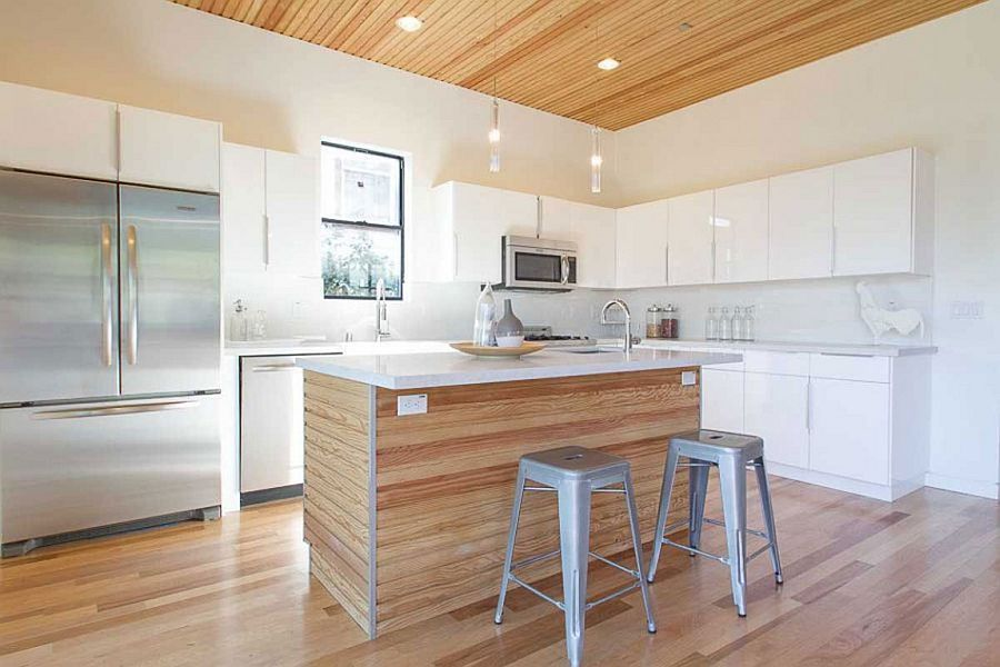 Stylish kitchen in white with a smart central island and breakfast counter