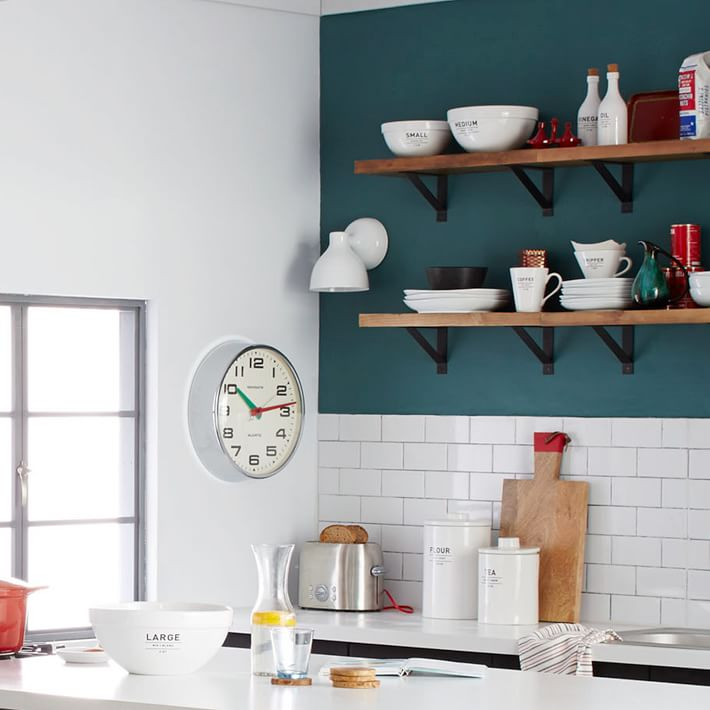 Teal kitchen with a subway tile backsplash