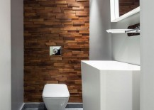 Textured wooden accent feature inside the small bathroom