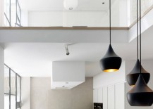 Tom-Dixon-lighting-in-a-modern-kitchen-and-dining-area-217x155