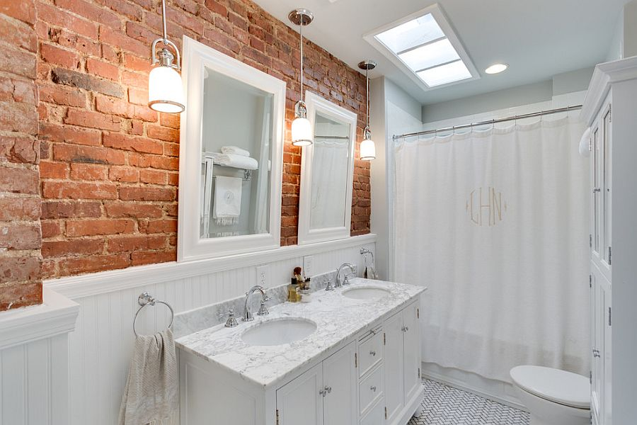 Traditional white bathroom with a brick backsplash [Design: The Ransom Company]