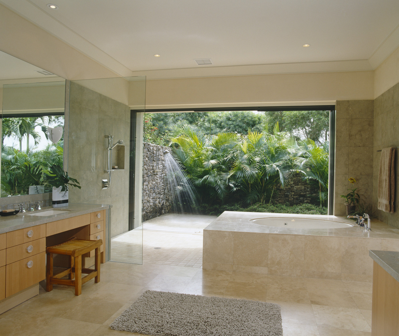 Tropical bathroom with vanity seating