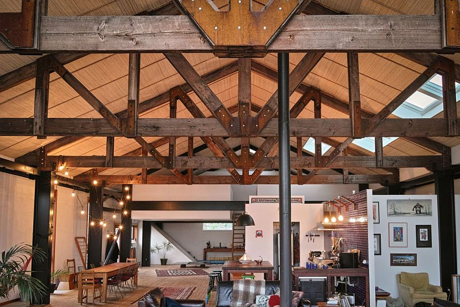 Trusses from the original house reused with elegance in the modern makeover