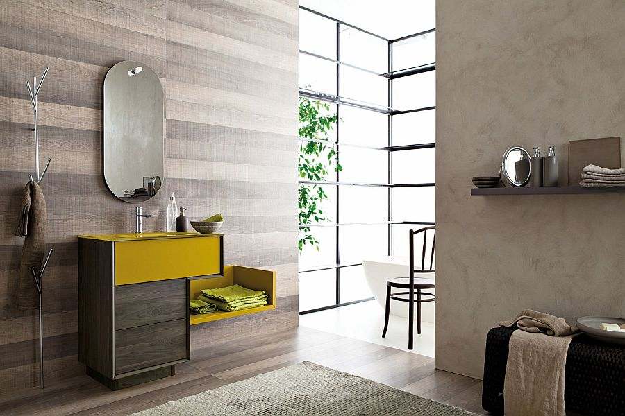 Vanity adds a hint of bright yellow to the bathroom in gray