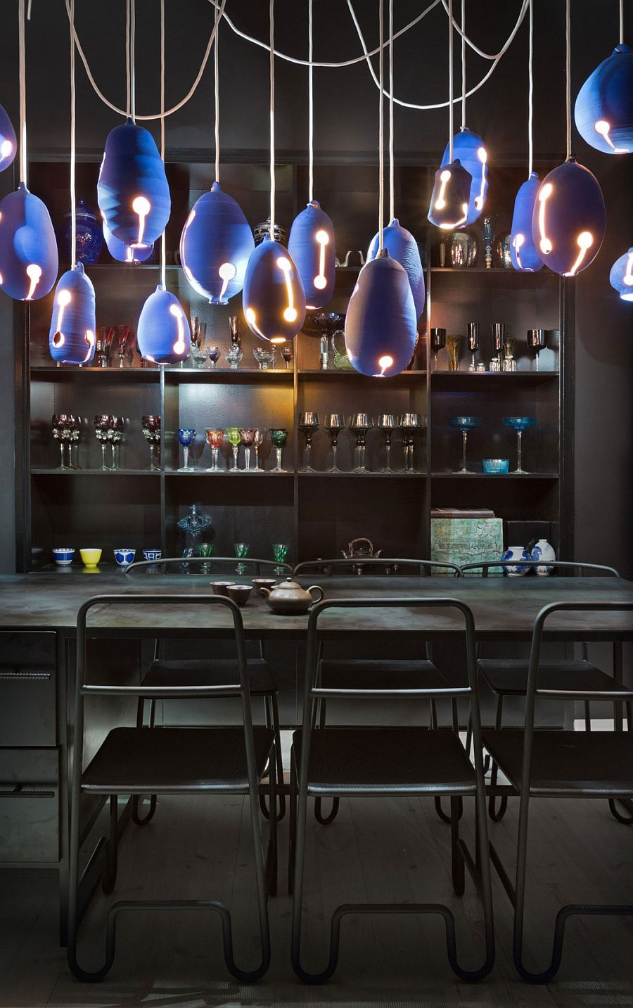 View In Gallery Vintage Colored Glasses And Bold Lighting For The Dark Dining Area