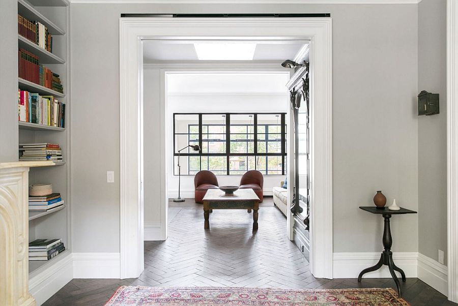 White and gray shape the neutral interior of the ravishing townhouse