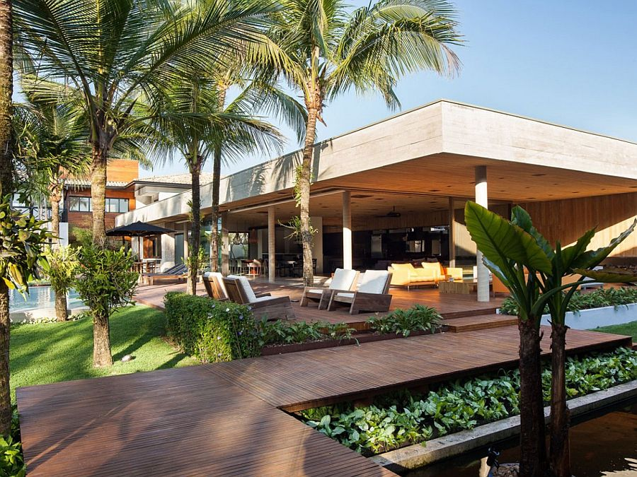 Wooden walkways around the pavilion connect it with existing house and additional spa zone A Luxurious Pavilion to Marvel At: House MZ in São Paulo
