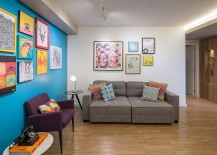 Accent blue wall and colorful wall art in the living room 217x155 Apartamento Trama: Fun and Fashionable Urban Hub in Brasilia