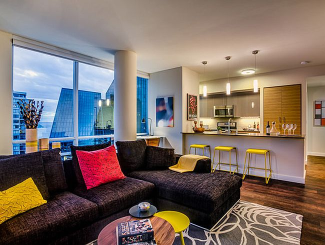 Accent pillows and bar stools add bright pops of color to the living area