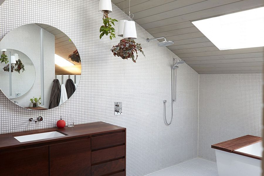 Add a hint of greenery to the contemporary bathroom