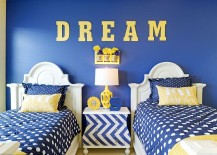 All blue kids' bedroom with a chevron pattern bedside table