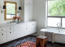 Bathroom with a colorful kilim rug