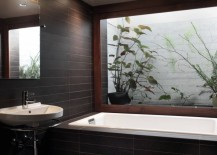 Bathroom with a view of plants